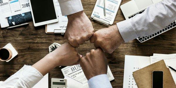 Business meeting group fist bump